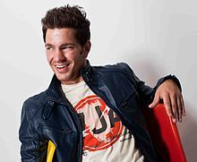 Andy Grammer:  Andy was born in in Los Angeles, but grew up in Chester, New York, graduating from Monroe-Woodbury High School.