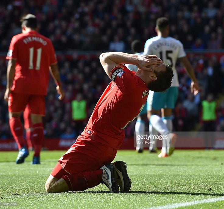 James Milner of Liverpool reacts during the Barclays Premier League match between Liverpool and Newcastle United at Anfield on April 23, 2016 in Liverpool, United Kingdom.