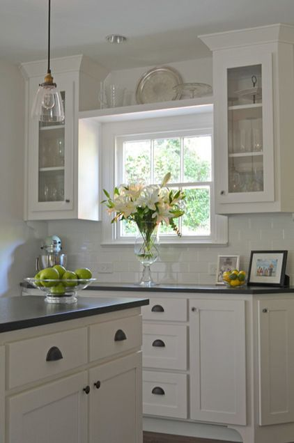 kitchen with display and window looking out elegant not over the top traditional kitchen by sar on kitchen cabinets around window id=45048