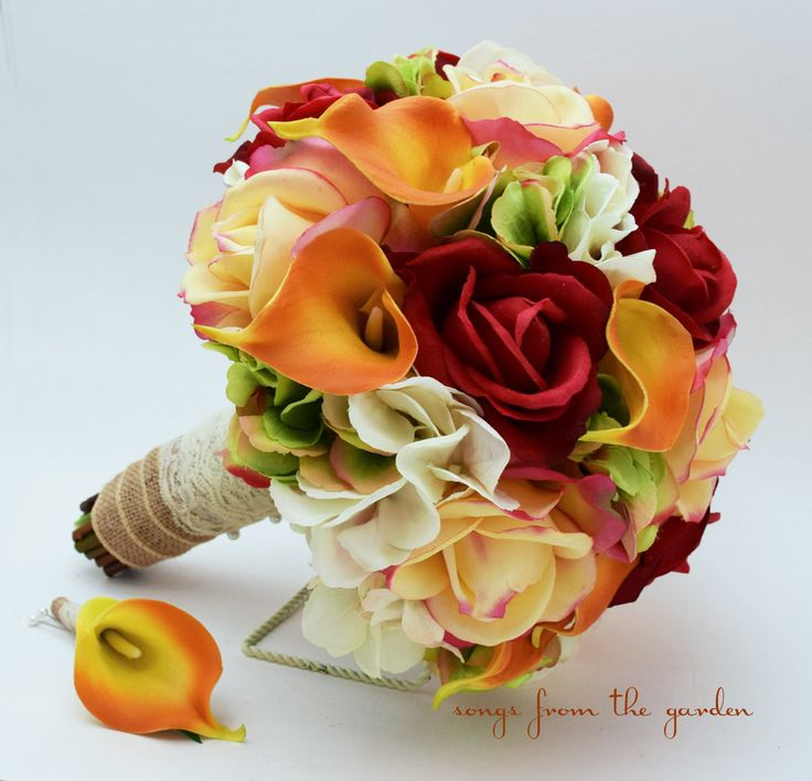 For your fall wedding, this gorgeous and fresh-feeling bouquet of real touch roses, calla lilies, and silk hydrangea can be yours to have and to hold on your wedding day. Place your order today or con