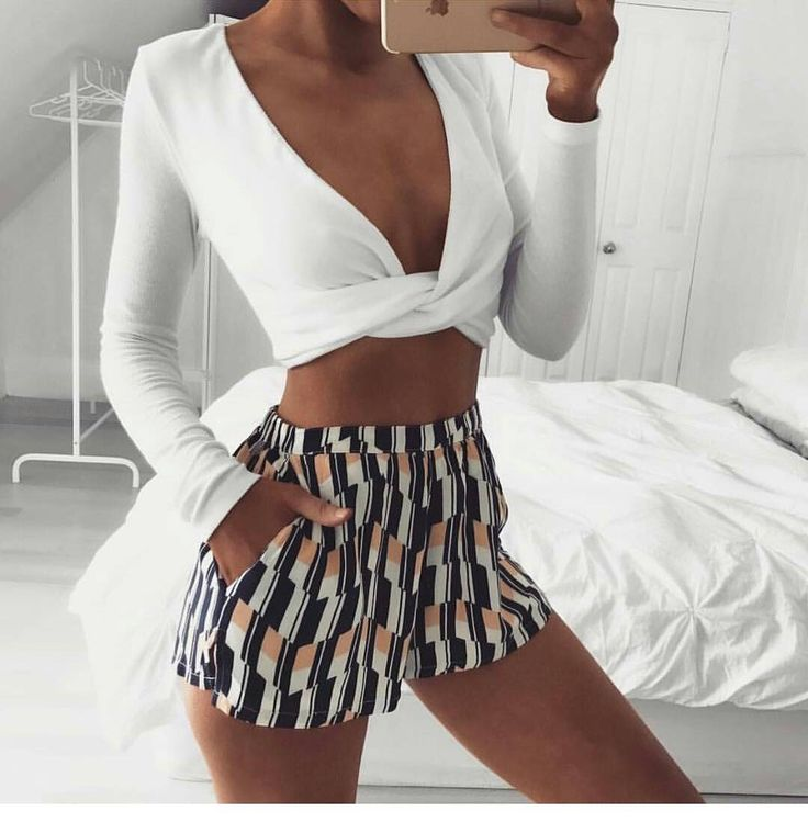 Summer outfit. With long sleeve wrap around top. High waist shorts with blue and white print. Summer outfit.