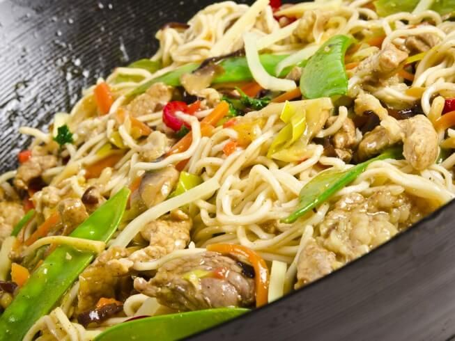 A recipe for Asian Chicken And Noodles made in the crock pot made with Oriental-flavor ramen noodle soup mix, boneless, skinless chicken thighs, baby-cut