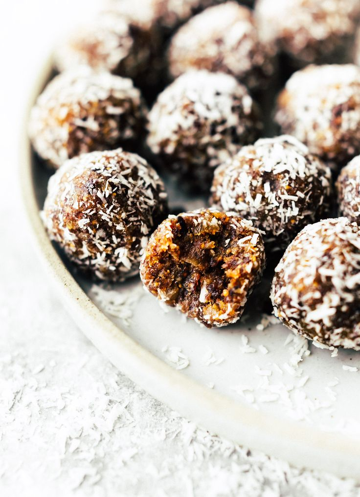 These No Bake Coconut Apricot Fig Bliss Bites are the perfect superfood energy bites! No sugar added, just figs, coconut, apricots, nuts, pure dark chocolate, and a touch of sea salt. A quick wholesome snack to fuel your day!! Paleo, Vegan, and Whole 30 friendly.