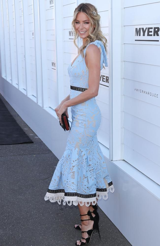 Jennifer Hawkins arrives in a pale blue Talulah dress for Oaks day.