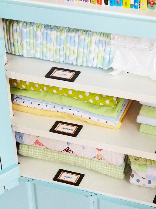 Love this storage system for wee little one's clothing and necessities. Via BHG