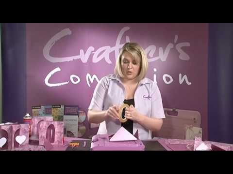 Sara Davies from Crafter's Companion introduces the Ultimate Crafter's Companion and continues to demonstrate the product. This is part 2 of a 3 part series....