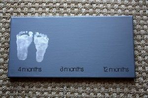 Baby's footprints as art - Have some baby showers coming up...Set up the canvas and give the footprint paint to go with it...