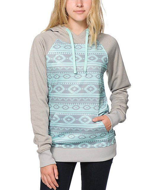 A long and slim fit body in a mint tribal print is accented by a grey hood and sleeves for a dynamic look, while the soft fleece lined interior offers a warm and comfortable wear.