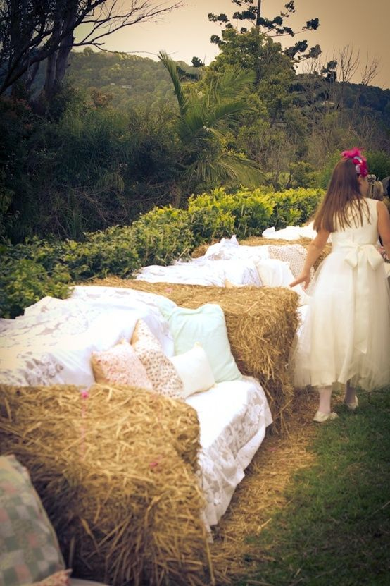 Hay bail sofas - luxury seating for a rustic wedding. You can add a bit of luxury by throwing some nice rugs and cushions on them.
