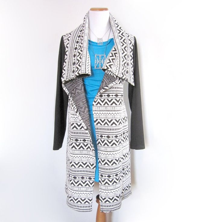 This jacket was designed by Tammy Beauvais (Mohawk Nation) and features a black and white geometric print throughout the front. Stay warm and look ...