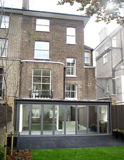 Subtle extension to a listed period home in St Johns Wood. Entire back of the property opens up to the garden.
