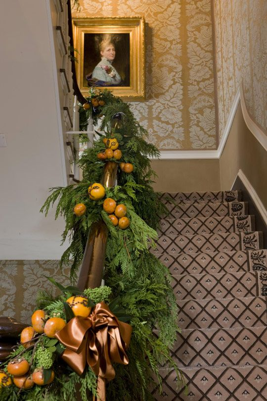 Barry Dixon, with Traditional Home and floral designer Barbara Hamilton  decorated the entry & DR at Blair House for Christmas. via Traditional Home®