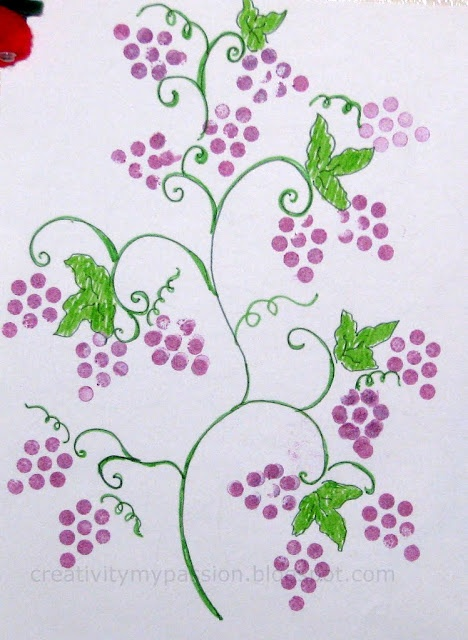 Use pencil erasers to make the bunches of grapes prints.