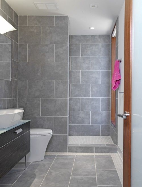 a house we are considering as open tiled showers similar to this the tile is brown not gray and it thankfully has no window right there at the shower - Floor Tile Designs