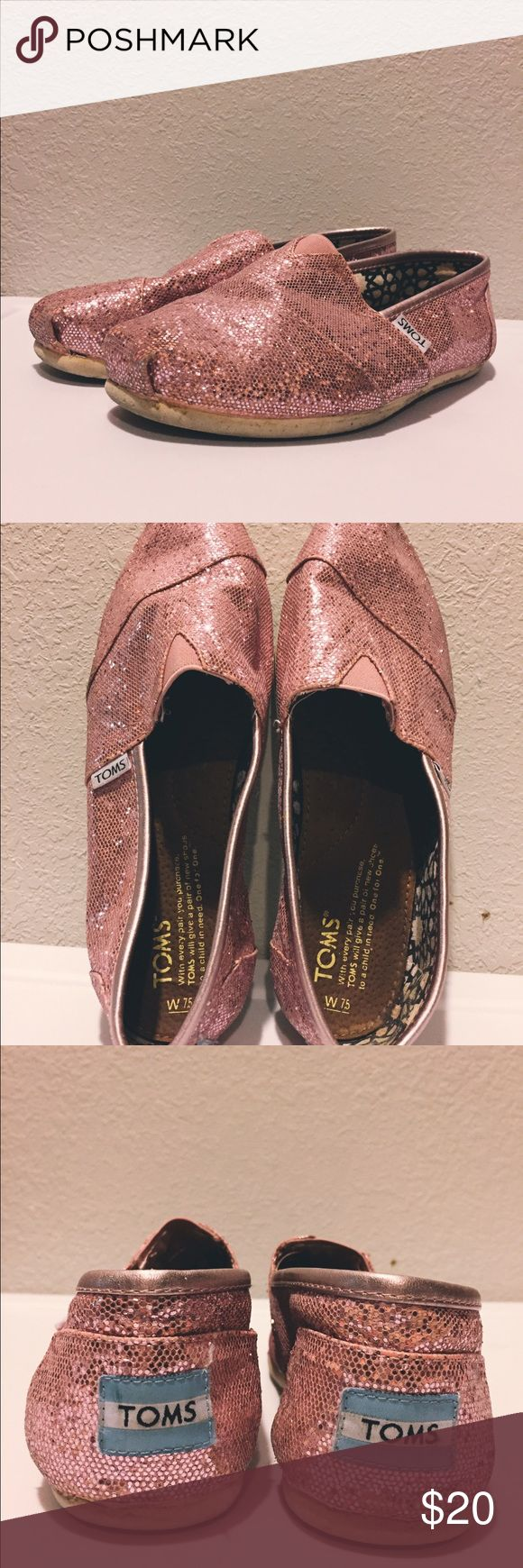 "Woman's pink glitter toms Worn but in good condition. They don't have the normal ""worn toms smell"" lol They are true to size and don't stretch. I haven't worn them in a reeeally long time. TOMS Shoes"