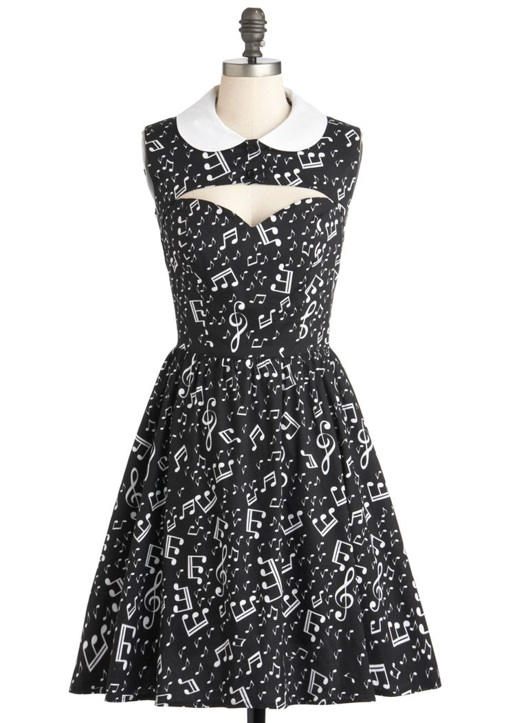 This dress is GREAT. Love it! Only wish it were colorful instead of black. Music notes & cute sweetheart neckline-cutout. Ooh La La-capella Dress | Mod Retro Vintage Dresses | ModCloth.com