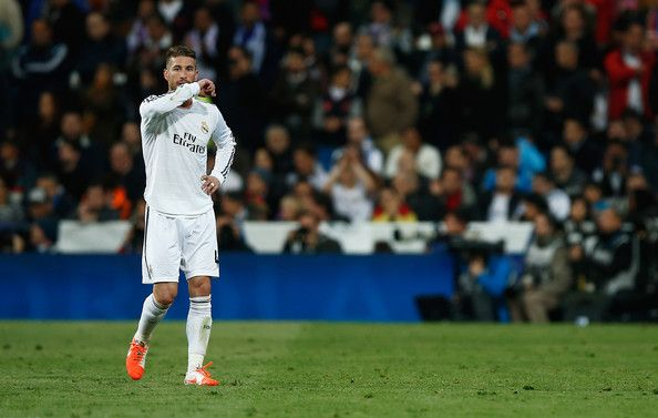 Sergio Ramos of Real Madrid leaves the field after being shown the red card during the La Liga match between Real Madrid CF and FC Barcelona at the Bernabeu on March 23, 2014 in Madrid, Spain.