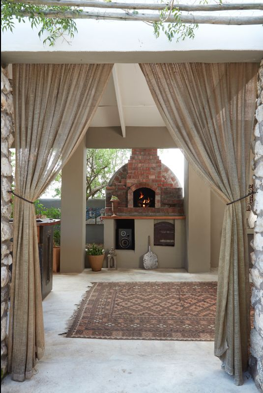 By Simone Borcherding stylist   writer   spacemaker. Clay brick pizza oven, kleim, concrete screed floors and hessian curtains.