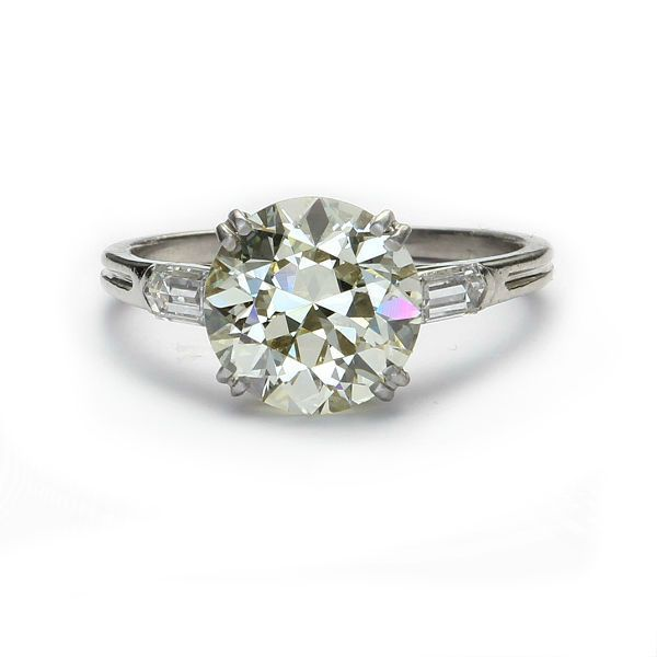 Circa 1930s Engagement Ring set with a stunning Old European cut diamond  2.85 cts and certified by  GIA. Platinum with bullet side diamonds.