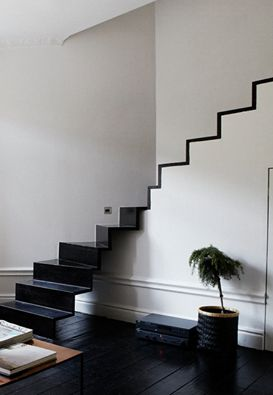 The modern simplicity of this stairwell is beautiful and striking