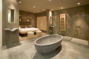 natuurstenen badkamer in combinatie met een slaapkamer