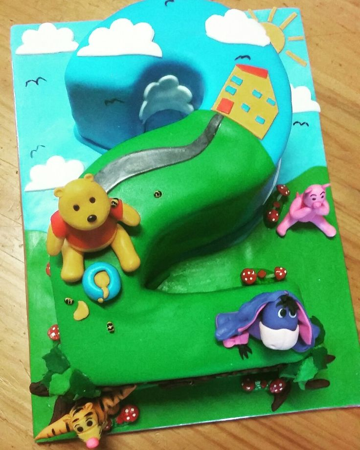 Winnie the pooh bear and friends number two cake.