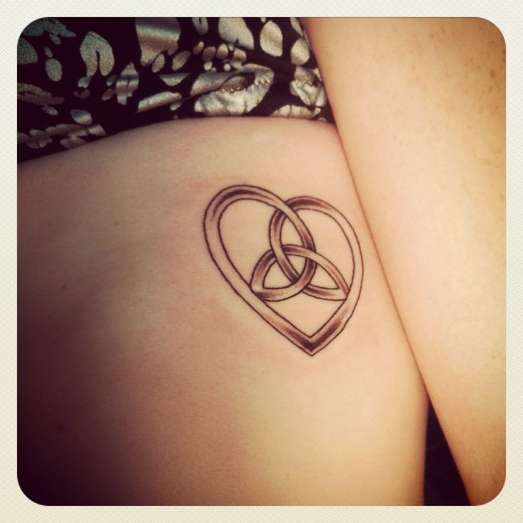 Celtic heart w/ interlocked trinity symbol....my first tattoo!  Representing the fact that no matter where I go in life, I will always have God!