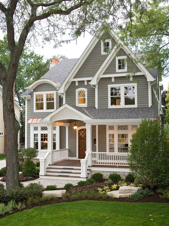 Love this exterior: paint color, wood stain (door and porch), white trim, windows and transom windows, roof peeks, attic windows, front door (I would add some transom windows on either side), porch light, porch railing & steps, etc.: