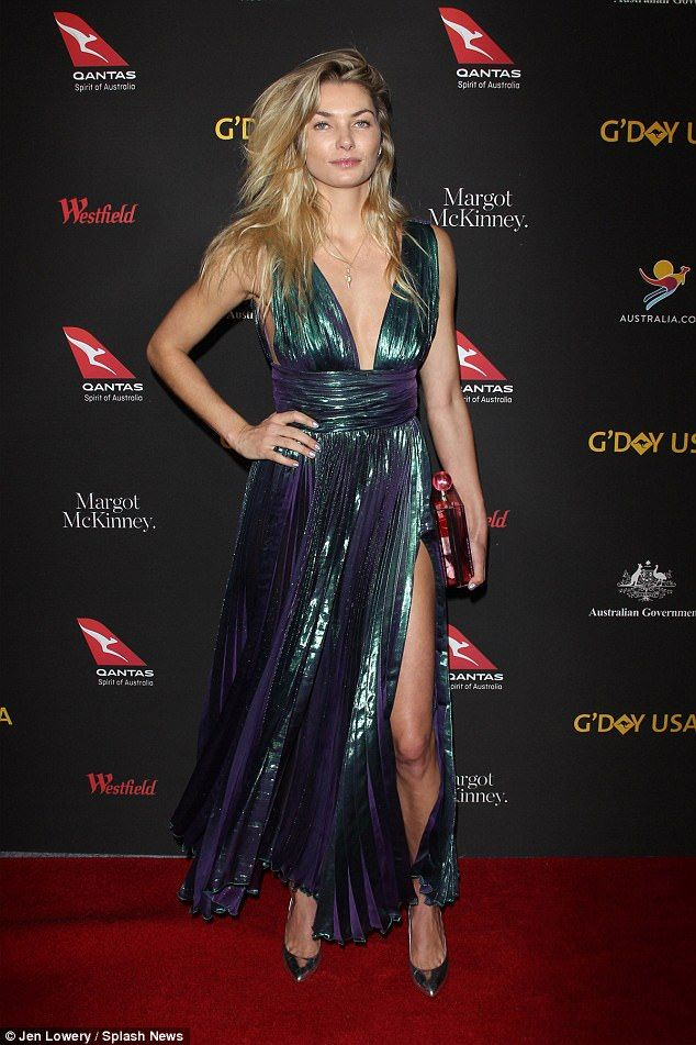 Leggy: Model Jessica Hart, 31, appeared to opt for a no-fuss makeup look and allowed her iridescent, floor-length gown to take centre stage