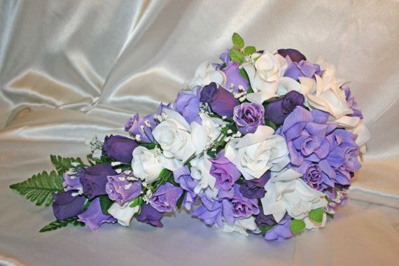 We would love to be apart of your wedding and meet your floral needs for your wedding flower package. Floral items that we provide are bouquets, silk floral alter arrangements, centerpieces, flower girl halos, kissing balls, head table arrangements, flower girl baskets, ring bearer
