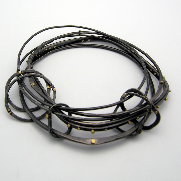 "Bracelet | NICHOLE COLLINS-USA Oxidized sterling silver and 18kt gold. ""Nichole Collins is a metalsmith and jewelry artist. She received a Bachelor of Fine Arts in Metalsmithing and Jewelry Design from The University of Kansas and has studied at Lahti Polytechnic in Lahti, Finland"" http://www.nicholecollinsjewelry.com/index.html"