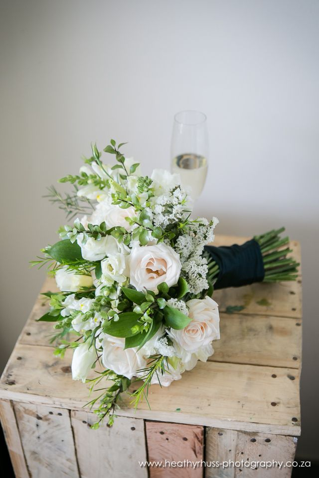 Rustic Bouquet of cream vendella roses, lisianthus, snapdragons, wax and natural greenery. Thanks to Heathyr Huss Photography