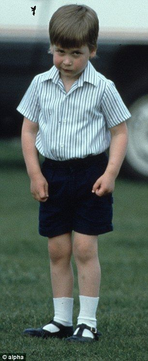 Double trouble: Four-year-old Prince William (left) gets bored while watching his dad play...