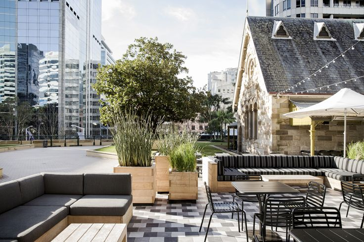 Exterior : The design incorporated a combination of high bar tables, robust moveable picnic tables, stools and chairs. In the centre of the northern courtyard the raised hexagonal podium was retiled using off white, grey and black ceramic tiles. This area was delineated from the other spaces with potted plants, mid-century umbrellas and built in furniture that was upholstered in black and white graphic fabrics. http://robertplumb.com.au