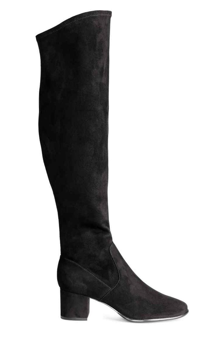 Long boots: Long boots in imitation suede with an elasticated shaft that finishes just above the knee, a zip in the side and covered block heels. Satin linings, imitation leather insoles and rubber soles. Heel 6 cm.