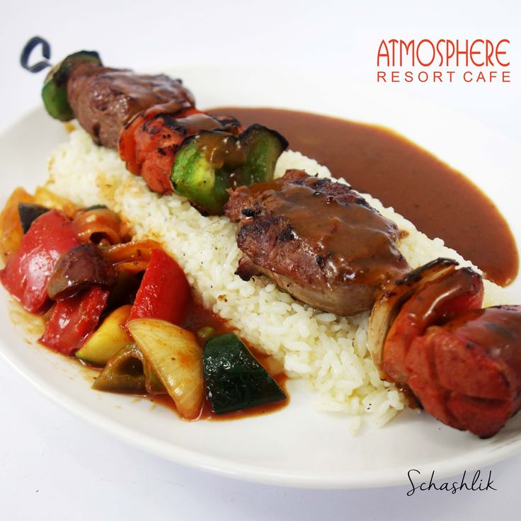 Grilled beef skewer with bratwurst, paprika, onion, tomato & smoky BBQ sauce