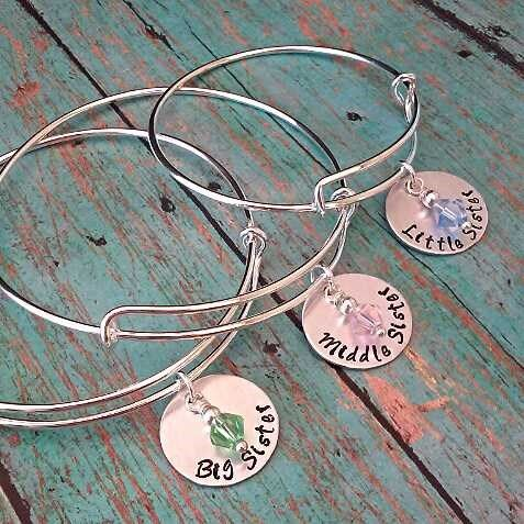 "These are great gifts to give sisters for the holidays, and come in child and adult sizes!  Your choice of ""Big Sister,"" ""Middle Sister"" and ""Little Sister"" are hand stamped onto a 3/4"" aluminum disc, with a swarovski crystal birthstone and your choice of a child size bracelet (50mm), adult size bracelet (65mm), 18"" or 20"" rolo necklace.**Aluminum is a great alternative to sterling silver. It is hypoallergenic, light in weight and will not tarnish. Each piece is personally sta..."