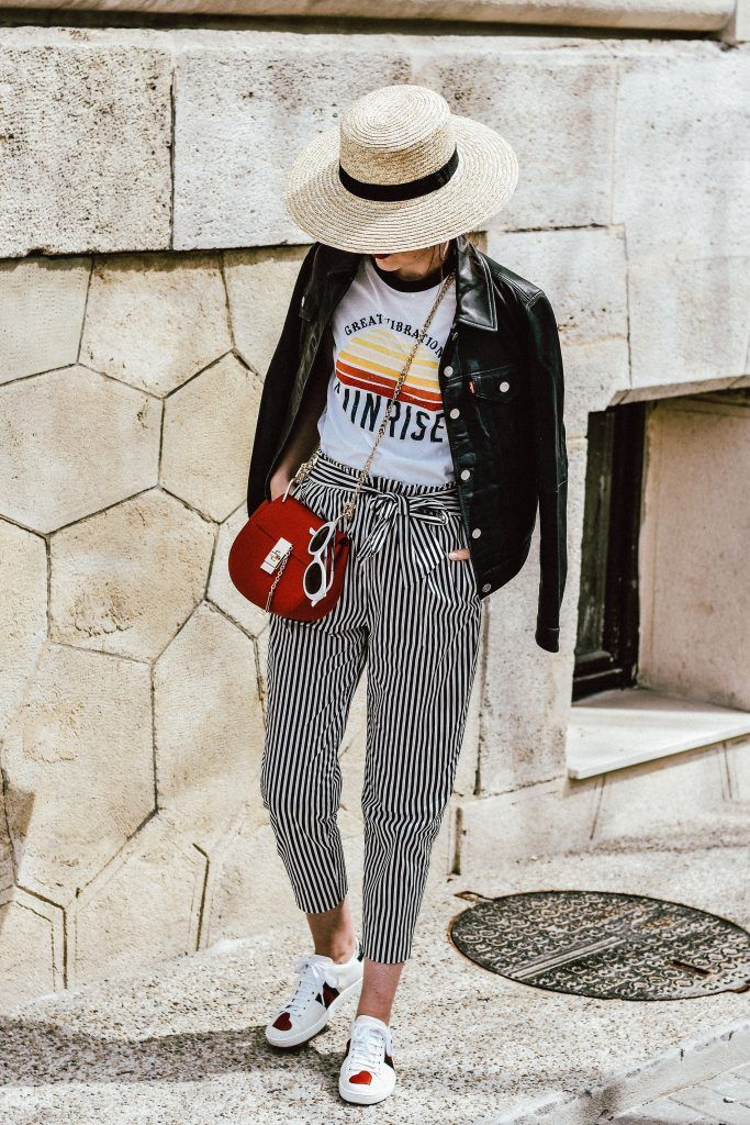 Zara paperbag striped pants with tie bow in front, mango retro graphic tee, asos printed tee, t-shirt, ace gucci sneakers, white leather sneakers, gucci sneakers with hearts, white kicks, chloe drew red crossbody bag, chloe drew lookalike bag, topshop straw hat, levis leather trucker jacket, genuine leather jacket, button down, silver hoop earrings, messy hair, bun, red lipstick, rivers island white sunglasses, retro sunglasses, sunnies, andreea birsan, couturezilla, cute spring outfit ideas…