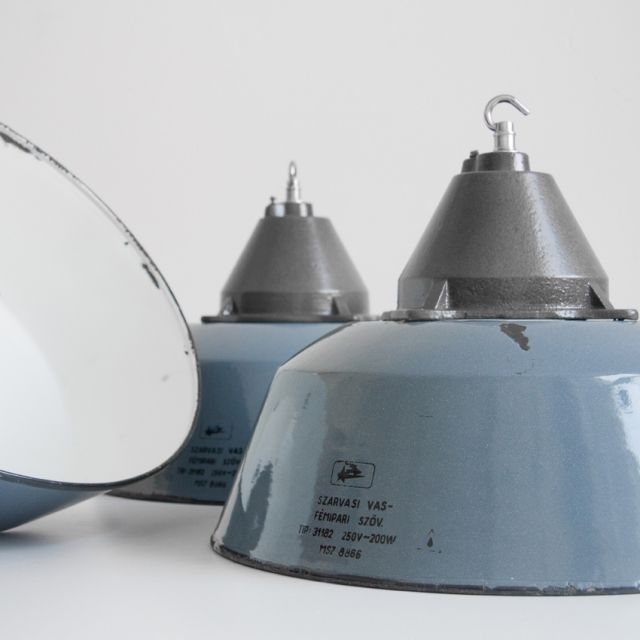Industrial hanging lights with worn enamel finish