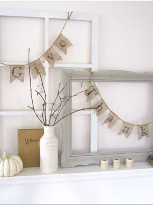 A mantel is decorated with chic accessories and stunning neutral colors
