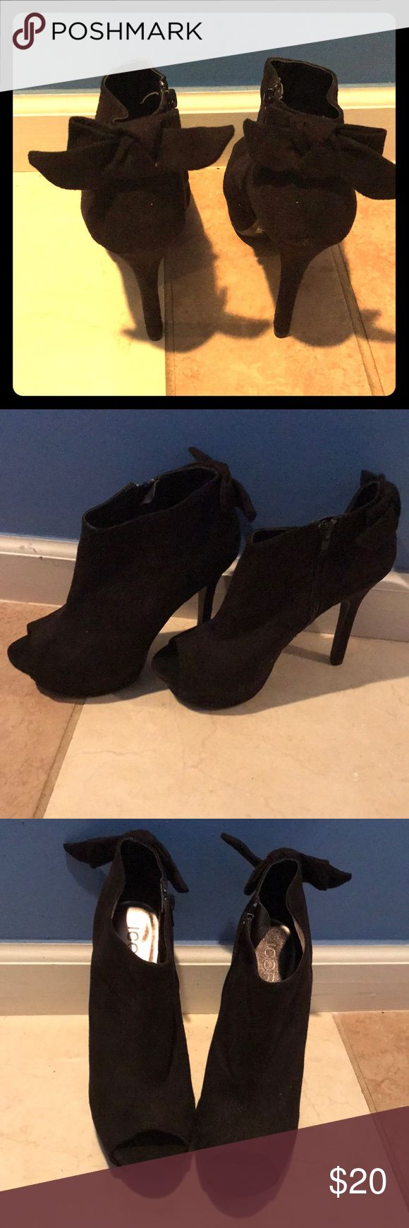Black heel booties Black suede heels, with bow on the upper heel toe out in front, and zipper on side Shoes Heels