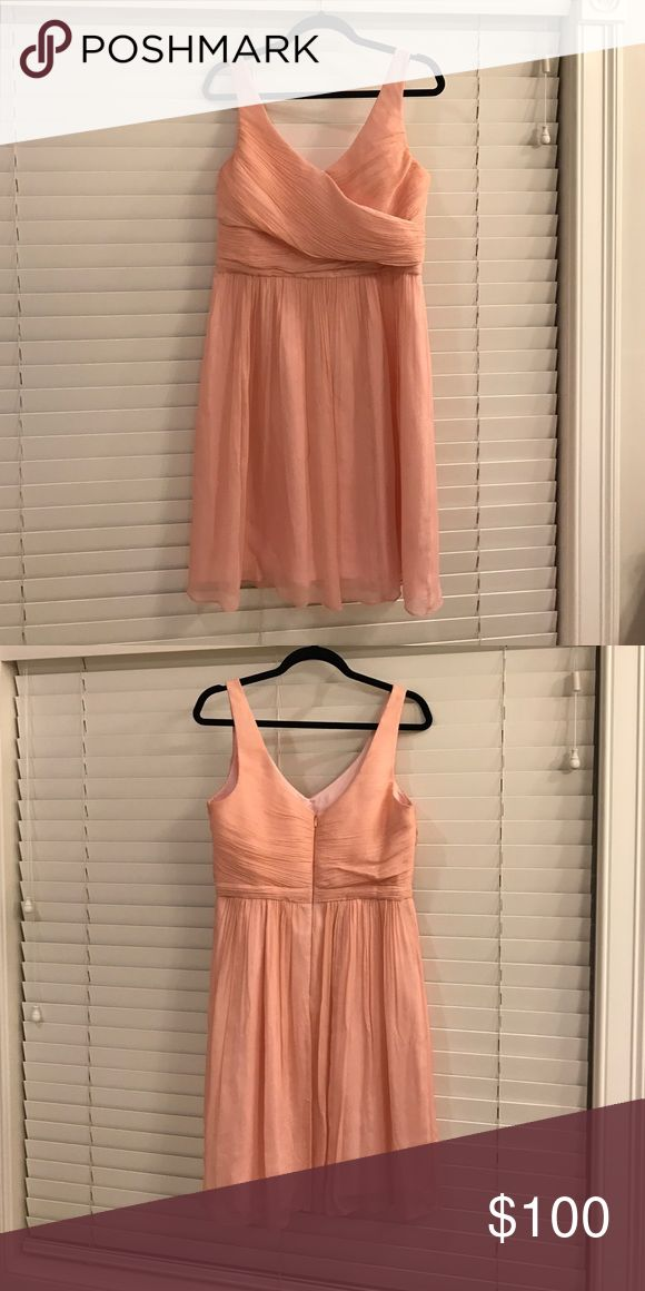 J Crew Bridal Bridesmaid dress Beautiful peach bridesmaid dress from J Crew bridal. V neck front and v neck back. Empire waist, material criss crosses across bust. Very flattering fit. 100% silk. Lining 100% polyester. J. Crew Dresses