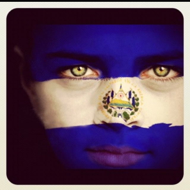 girl with the salvadorian flag painted on her face