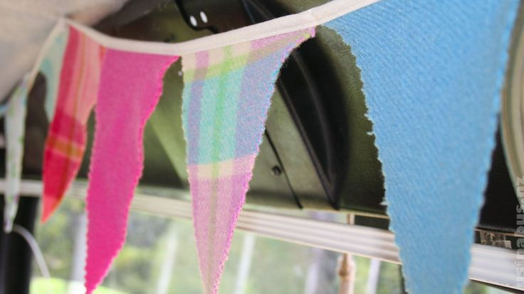 Family travel blog in NZ.  Bunting made from recycled blanket.  Us in a bus.
