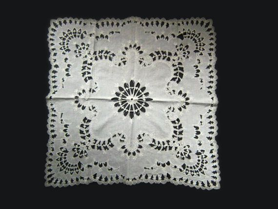 Very nice doily from the Italian estate Im currently listing here. 24 square. Linen with cotton chain stitch bordering the cutwork.  It is in
