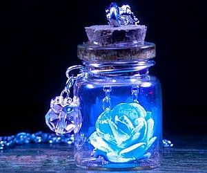Glowing Blue Rose Necklace