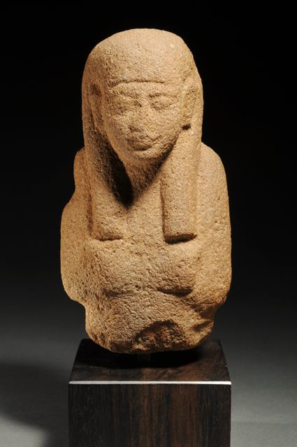 EGYPTIAN AMARNA PERIOD SANDSTONE DEEP BUST OF A NOBLEMAN |  With a long tripartite wig and crossed arms; from an ushabti. From the time of Akhenaten the heretic pharaoh who abandoned the cult of Amun, instituted the cult of the Aten, and built a new capital at a site now called Tel al Amarna. Sandstone ushabtis of this period are rare.  XVIIIth Dynasty, ca. 1350-1334 BC