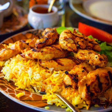 kuku choma (grilled chicken) with rice or fries