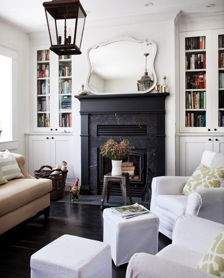 Donna Griffith via House and Home {white rustic vintage modern living room}.....