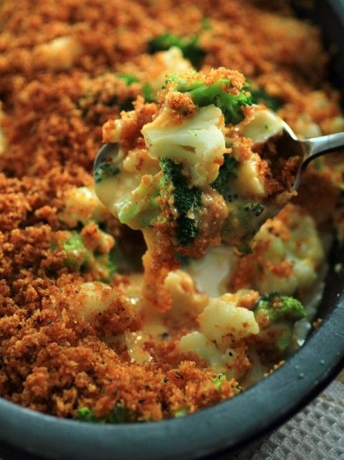 Broccoli and Cauliflower Cheese Bake. Look at that ooey gooey cheese with those deliciously crispy bread crumbs. This recipe will surprise you, it is not made with a traditional cheese sauce, so pop on over to check it out!